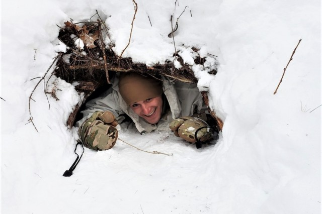 A student in the Cold-Weather Operations Course (CWOC) Class 19-05, which included many Soldiers from the 75th Ranger Regiment, checks out an improved shelter Feb. 23, 2019, at Fort McCoy, Wis. CWOC students are trained on a variety of cold-weather subjects, including skiing and snowshoe training as well as how to use ahkio sleds and other gear. Training also focuses on terrain and weather analysis, risk management, cold-weather clothing, developing winter fighting positions in the field, camouflage and concealment, and numerous other areas that are important to know in order to survive and operate in a cold-weather environment. The training is coordinated through the Directorate of Plans, Training, Mobilization and Security at Fort McCoy.