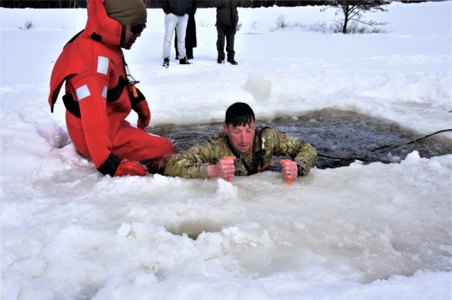 A student in the Cold-Weather Operations Course (CWOC) Class 19-05, which included many Soldiers from the 75th Ranger Regiment, participates in cold-water immersion training March 5, 2019, at Fort McCoy, Wis. CWOC students are trained on a variety of cold-weather subjects, including skiing and snowshoe training as well as how to use ahkio sleds and other gear.