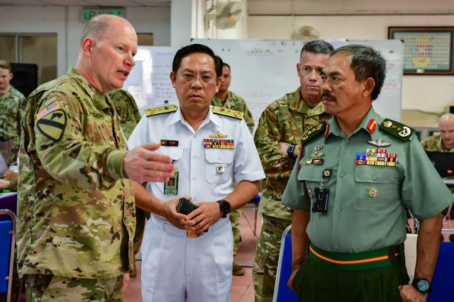 Col. Kevin McMahan, Washington Army National Guard, briefs Malaysian Armed Forces Joint Force Headquarters Chief of Staff, Maj. Gen. Dato' Haji Mohd Yusof Bin Aziz (right) and Deputy Chief of Staff Flotilla Admiral Chan Peng Cheong (center) prior to the start of Exercise Bersama Warrior, March 8, 2019. Bersama Warrior is a joint bilateral exercise between the Malaysian Armed Forces and the United States Army Pacific (USARPAC). The exercise focused on planning and conducting joint and coalition peace enforcement operations and was held in Kuala Lumpur from March 7-15, 2019.