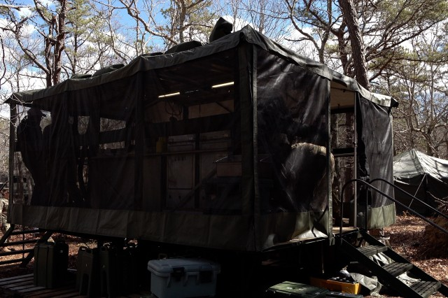 """Food Service Specialists competing for the Philip A. Connelly Award Program for Excellence In Army Food Service from the 1058th Transportation Company, Massachusetts Army National Guard, serve chicken parmesan out of a Mobile Kitchen Trailer (MKT) during a field exercise here, March 20, 2019. """"Dedication from the Food Service Section and the supporting elements of the Field Sanitation Team, Kitchen Patrol Members, Cash Collection NCO, and Head Counter saw the section compete and succeed at the Regional level June 2018. We are excited to have been selected to participate at the Department of Army level,"""" said Sgt. 1st Class Katherine Cross, 1058th TC."""