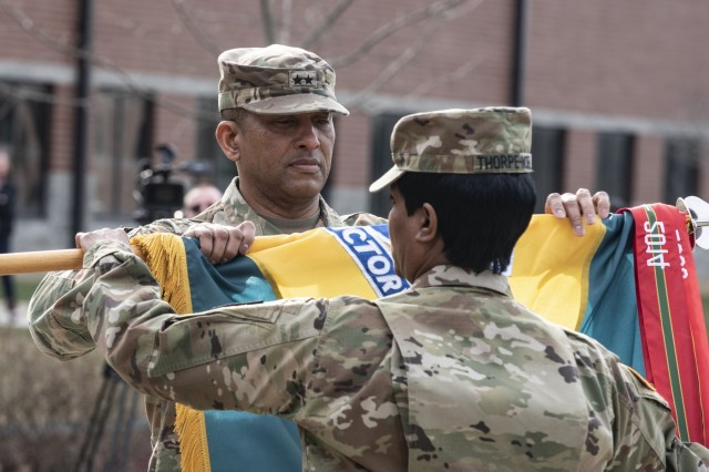 Maj. Gen. Jason T. Evans, U.S. Army Human Resources Command commanding general, furls the HRC unit colors during a repatching ceremony held at the Lt. Gen. Timothy J. Maude complex located on Fort Knox, Ky., March 20, 2019. Nearly 18 months prior, the Army designated HRC as a direct reporting unit to HQDA G1. As a DRU, HRC provides the distribution and strategic talent management of active and reserve component Soldiers and executes personnel-related programs and services Army-wide to ensure readiness and strengthen an agile and adaptive Army. (U.S. Army photo by Master Sgt. Brian Hamilton/released)