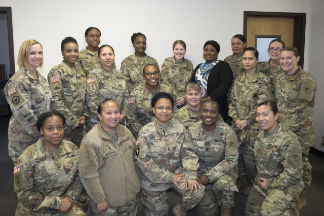 Attendees of the 1st Theater Sustainment Command's (TSC) Sisters in Arms meeting pose for a group shot March 15.