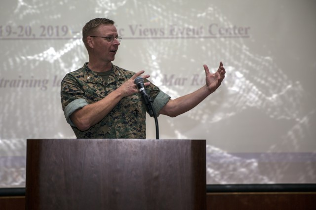 U.S. Marine Corps Col. Joseph D. Williams, chief of staff, Marine Corps Installations-West (MCI-W), discusses the command's Environmental Security Program with the California Energy Compliance Agency during an Environmental Law Training Symposium at the Pacific Views Event Center, MCB Camp Pendleton, California, March 19, 2019. Since 1994, the Western Area Counsel Office has hosted an Environmental Law Training Symposium to provide updates in environmental and land use law, regulations, and policies. (U.S. Marine Corps photo by Cpl. Emmanuel Necoechea)