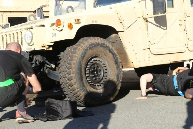 """FORT SHAFTER FLATS, Hawaii - How many company commanders does it take to change a tire? In this case, it looks like one. Company commanders, first sergeants and other members of command teams from across the 9th Mission Support Command, the U.S. Army Reserve command of the Pacific, change tires on HMWVVs at the Fort Shafter motor pool as part of """"How to BA Day,"""" a full day of physical and mental training for company level leadership during the 2019 Pacific Pride Leaders Workshop. The command teams experienced first hand the standards expected of their Soldiers, including maintenance essentials such as Preventative Maintenance Checks and Services."""