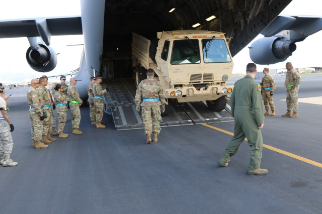 JOINT BASE HICKAM-PEARL HARBOR, Hawaii - Hawaii Air National Guard 204th Airlift Squadron train Army Reserve 9th Mission Support Command command teams on how to properly load and tie down vehicles into a C-17 Globemaster.
