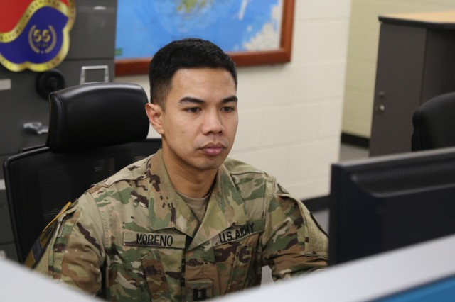 U.S. Army Capt. Rondolf Moreno, a plans officer with the 19th Expeditionary Sustainment Command, who majored in Systems Engineering for his Master's Degree at the Naval Postgraduate School in Monterey, Calif., works at his office at the 19th ESC Headquarters March 21, 2019, at Camp Henry, Daegu, Republic of Korea. Moreno recently attended two conferences to present his research in Systems Engineering to the greater, global engineering community at Orlando, Fla. and Oxford, England, respectively. Moreno earned his education through the Army's Career Satisfaction Program, Graduate School Option. (U.S. Army photo by Korean Augmentation to the U.S. Army Cpl. Jeong, Ji Hun)