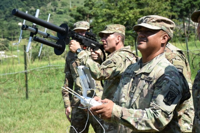 Col. Richard Wright prepares takes aim at an unmanned aerial system remotely controlled by as Command Sgt. Maj. Wilfredo Suarez, August 20, 2018, at Combined Task Force Defender. The 35th Air Defense Artillery Brigade command team received a hands-on briefing on E/6-52 AMD's counter-UAS capabilities.