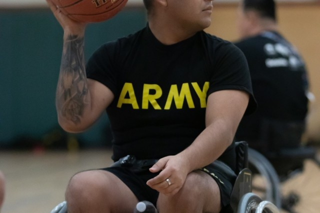 Spc. Jesus Flores sets up his shot during wheelchair basketball practice at Joshua W. Soto Physical Fitness Center at Fort Bliss, Texas, March 13. Flores is currently competing in the 2019 Army Trials, an adaptive sports competition from March 6-16 with nearly 100 wounded, ill and injured active-duty Soldiers and veterans competing in 14 different sports for the opportunity to represent Team Army at the 2019 Department of Defense Warrior Games in Tampa, Fla.