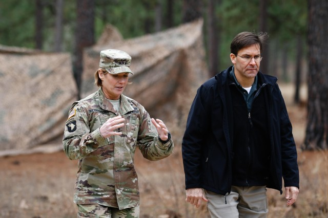 Lt. Gen. Laura J. Richardson, acting commanding general of the Forces Command, and Secretary of the Army Dr. Mark T. Esper discuss unit readiness during a warfighter exercise at Fort Bragg, N.C., on Feb. 9, 2019.