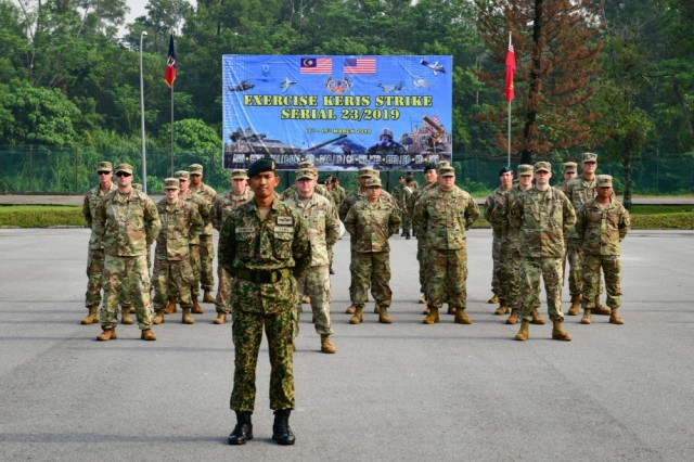 Soldiers from the Washington National Guard and the 25th Combat Aviation Brigade, 25th Infantry Division stand in formation during the opening ceremony of Exercise Keris Strike, March 11, 2019. Keris Strike is a joint bilateral exercise hosted by the Malaysia Armed Forces 4th Division held March 11-15, 2019 near Kuala Lumpur, Malaysia. The exercise consisted of a series of subject matter expert exchanges (SMEE) designed to develop the capacity to quickly respond to crisis with greater interoperability, increase mission effectiveness and develop unity of action within the joint U.S. and Malaysia Armed Forces.
