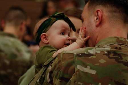A child reacts to seeing her dad returning home from a deployment at Fort Carson, Colo., March 9, 2019. The 4th Combat Aviation Brigade deployed to Europe as part of the regionally allocated forces supporting Operation Atlantic Resolve, an important mission for strengthening relationships and interoperability amongst allies and partners.