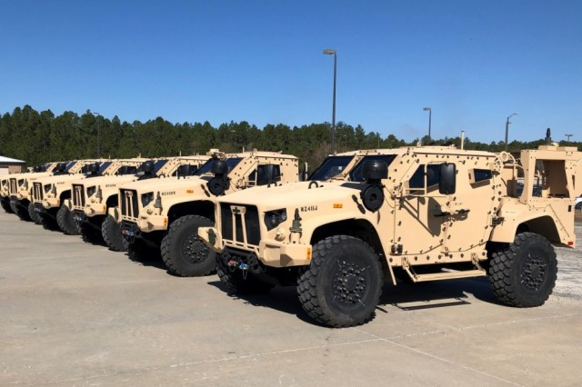 The first six Joint Light Tactical Vehicles (JLTV) to be delivered to Soldiers from the 1st Armored Brigade Combat Team, 3rd Infantry Division, are staged before being driven to their respective battalion motorpools. Raider Brigade Soldiers are the first in the Army to be fielded the new JLTV.