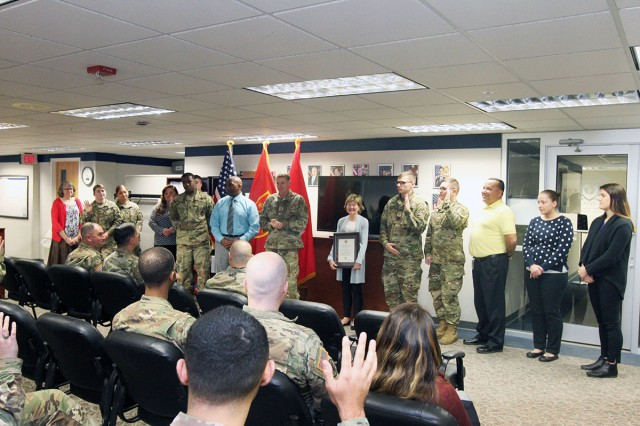 The Fort Sill Legal Assistance team stands with the commanding general as they are recognized for excellence March 12, 2019, in their office on the fourth floor of Bldg. 4700.