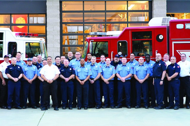 Members of the Fort Jackson Fire Department, named the 2018 IMCOM Fire Department of the Year, small category, pose in front of two of their fire engines. Since the department won the garrison-wide competition in its division, the installation will be in the running for at-large Army recognition.