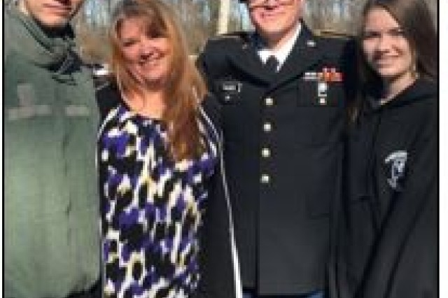 On Jan. 31, Sgt. 1st  Class Scott Palmer, joined by son, Bailey, l-r, wife, Brandi and daughter, Chloe,   graduated from Basic Combat Training at Fort Benning Ga.  Palmer entered Warrant Officer Candidate School Feb. 12 and is scheduled to attend the Warrant Officer Basic Course in the spring of 2019 at the Cyber Center of Excellence. Palmer is one of many new sister services recruits transitioning from the Air Force after completing over 20 years of Service, while continuing to serve as a prospective Cyberspace Operations Technician, 170A. (Courtesy photo)