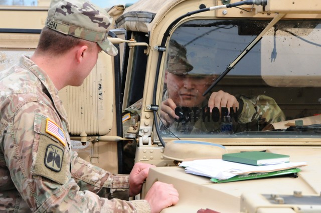Soldiers prepare a vehicle for deployment to Fort McCoy, Wisc., March 1.