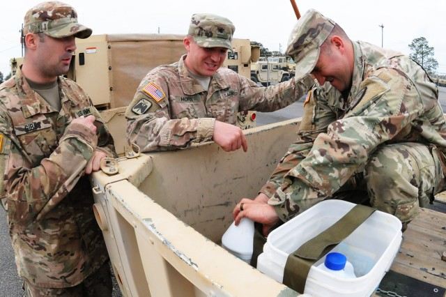Soldiers clean and prepare equipment March 1 prior to deploying to Fort McCoy, Wisc., for an exercise.
