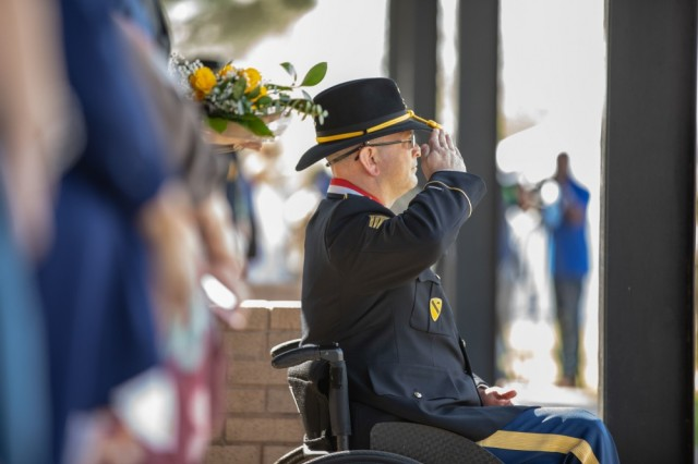 Sgt. (R) Daniel Cowart renders honors to the colors during a retreat ceremony conducted March 20 on Cooper Field on Fort Hood, Texas. Cowart was awarded the Distinguished Service Cross during the ceremony.