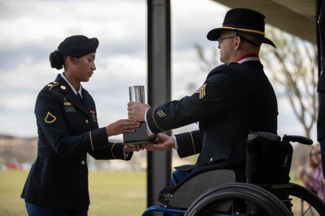 Sgt. (R) Daniel Cowart receives a ceremonial round fired in his honor during a retreat ceremony conducted March 20 at Fort Hood's Cooper Field, Texas. Cowart was awarded the Distinguished Service Cross during the ceremony.