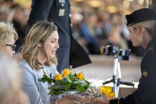 Sarah Cowart, spouse of Sgt. (R) Daniel Cowart, is presented the traditional cavalry bouquet of yellow roses during a retreat ceremony conducted March 20 on Fort Hood's Cooper Field, Texas. Sgt. Cowart was awarded the Distinguished Service Cross for his actions taken in Iraq in 2007.