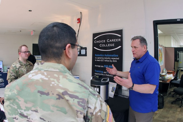 Glenn Waters, Choice Career College representative, talks to Soldiers about the robotics training offered through the college onsite at the Fort Sill SFL Transition Complex Feb. 28, 2019. The program expanded from a two-week course to a 15-week training program.