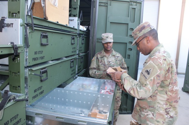 Soldiers from the 123rd Brigade Support Battalion draw items ordered by customers.