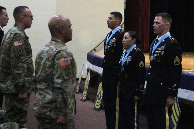 New inductees of the Fort Sill Chapter of the Sgt. Audie Murphy Club lead fellow members in reciting their creed at a ceremony March 12, 2019. From left are Sgt. 1st Class Francisco  Soto, of 1-31st FA; and Staff Sgt. Miriam Reyes and Staff Sgt. Daniel Cook, both of 1-40th FA.