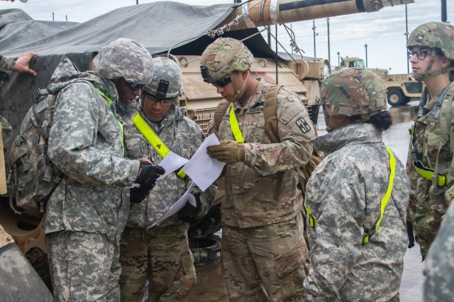 Soldiers from 13th ESC look for deficiencies on equipment before being moved and rail loaded at the Fort Hood Railhead Operations Center. During rail load certification March 13-14, 75 Soldiers from 13th ESC trained on issues that would make rail loading equipment impossible or create a safety risk. (U.S. Army photo by Sgt. 1st Class Kelvin Ringold)
