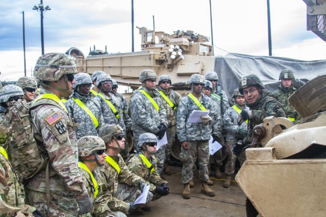 Gunnery Sgt. Carlos Pastora, 1st Tank Battalion, 1st Marine Division, instructs Soldiers from 13th ESC on deficiencies to look for before equipment can be moved and rail loaded at the Ft. Hood Railhead Operations Center. During rail load certification March 13-14, 75 Soldiers from 13th ESC trained on issues that would make rail loading equipment impossible or create a safety risk. (U.S. Army photo by Sgt. 1st Class Kelvin Ringold)