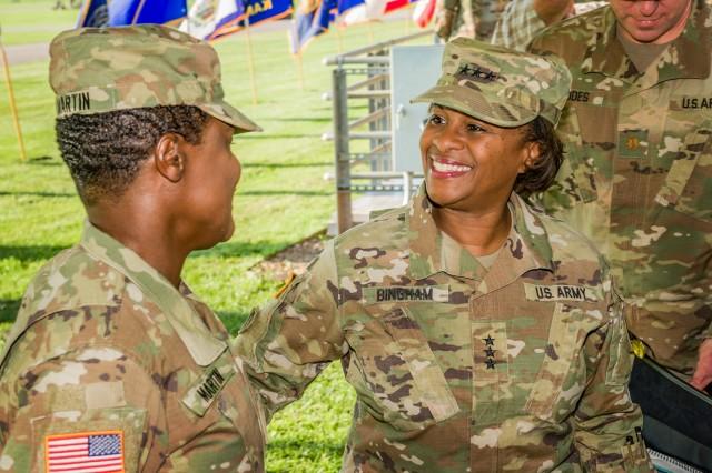 Lt. Gen. Gwen Bingham talks with Maj. Gen. Donna Martin, Maneuver Support Center of Excellence and Fort Leonard Wood commanding general, after promoting her to major general Aug. 28, 2018.