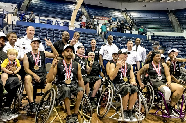 Lt. Gen. Gwen Bingham, back row left, cheeers members of the Army wheelchair basketball team June 9, 2018, at the 2018 Department of Defense Warrior Games held at the U.S. Air Force Academy in Colorado Springs, Colo. The Army team won top honors at the Warrior Games.