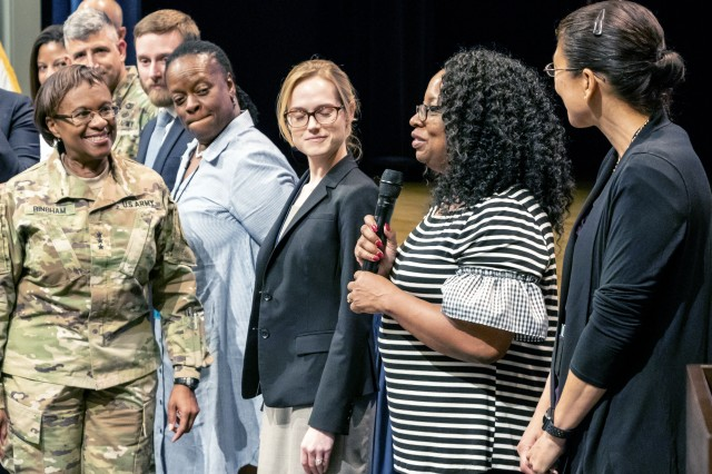 Lt. Gen. Gwen Bingham (left) talks with new employees during an Assistant Chief of Staff for Installation Management town hall in the Pentagon. Bingham holds quarterly town halls to enhance communication with members of the ACSIM team.