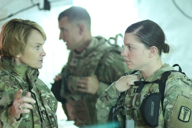 """Col. Mary V. Krueger (left), commander, Tripler Army Medical Center, meets with Capt. Jessica Dirks (right), commander, Bravo Company, 121st Combat Support Hospital, during the 121st CSH field training exercise, """"Operation Forlorn Reaper,"""" in Dongducheon, South Korea, Mar. 12."""