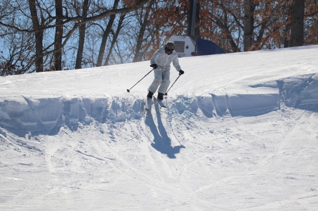 A student in the Fort McCoy Cold-Weather Operations Course (CWOC) Class 19-06 practices skiing March 11, 2019, at Whitetail Ridge Ski Area at Fort McCoy, Wis. In addition to skiing, CWOC students are trained on a variety of cold-weather subjects, including snowshoe training as well as how to use ahkio sleds and other gear. Training also focuses on terrain and weather analysis, risk management, cold-weather clothing, developing winter fighting positions in the field, camouflage and concealment, and numerous other areas that are important to know in order to survive and operate in a cold-weather environment. The training is coordinated through the Directorate of Plans, Training, Mobilization and Security at Fort McCoy. (U.S. Army Photo by Scott T. Sturkol, Public Affairs Office, Fort McCoy, Wis.)