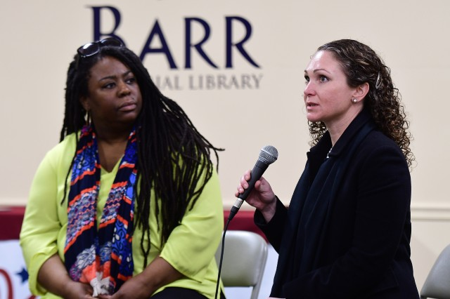 """Eileen Rivers (left), digital content editor for USA Today and author of a new book titled """"Beyond the Call: Three Women on the Front Lines in Afghanistan,"""" listens as Maj. Johanna Hipp, former female engagement team chief, explains her role in Afghanistan during an Authors at Your Library event in Barr Memorial Library March 21, 2019. Hipp is one of three American women featured in the factual account."""