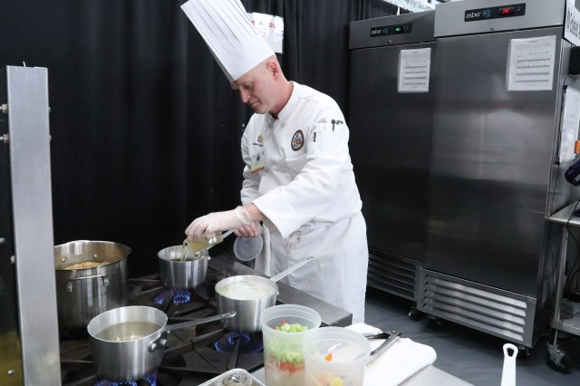 Sgt. 1st Class Gabriel Aquilano of U.S. Army Cyber Command (ARCYBER) stirs a sauce during the 2019 Joint Culinary Training Exercise at Fort Lee, Va., March 14, 2019. Aquilano, who serves as enlisted aide for ARCYBER commander Lt. Gen. Stephen Fogarty, earned a gold medal in the Hot Food Challenge portion of Enlisted Aide of the Year competition at this year's JCTE. More than 200 military chefs from all U.S. services and three allied nations took part in the overall 2019 competition.