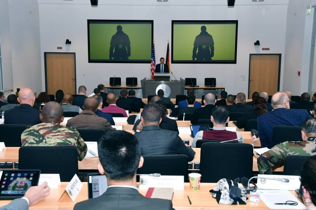GARMISCH-PARTENKIRCHEN, Germany (March 13, 2019) - Retired U.S. Air Force Brig. Gen. Dieter Bareihs, U.S. deputy director at the George C. Marshall European Center for Security Studies, welcomes 63 participants from 47 countries to the Program on Terrorism and Security Studies March 13. (DOD photo by Karl-Heinz Wedhorn/RELEASED)