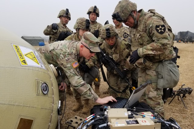CAMP HUMPHREYS, South Korea - Capt. Zachary Schofield, assistant product manager with Wideband Enterprise Satellite Systems, demonstrates how to use the new Combat Service Support Very Small Aperture Terminal (CSS VSAT) Inflatable Satellite Antenna (ISA) to Soldiers from the 2nd Battalion, 2nd Combat Aviation Brigade maintenance and support company. Schofield and his team are demonstrating the system in while the Soldiers are on a two-week field exercise, in order to show the ISA's ease of use during real world missions.