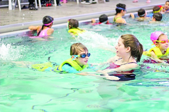 Instructors at Long Fitness Center help children learn how to swim during Spring Break.