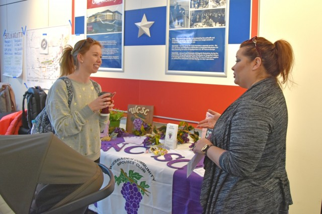 Sarah Graham (left), military spouse, gets information on volunteering from Grace Lauer, Wiesbaden Community Spouses' Club Thrift Shop manager, during a volunteer fair Feb. 22 at the Exchange on Hainerberg. People interested in volunteering should contact ACS or the organization they want to volunteer with and register with Army OneSource