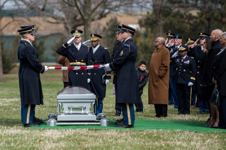 Soldiers from the 3d U.S. Infantry Regiment (The Old Guard) helps conduct military funeral honors with funeral escort for U.S. Army Air Forces Capt. Lawrence Dickson in Section 60 of Arlington National Cemetery, Arlington, Va., March 22, 2019. Dickson, a World War II Tuskegee Airman (100th Fighter Squadron, 332nd Fighter Group), went missing in action over Italy in December 1944 when his plane crashed during his return from an aerial reconnaissance mission. His P-51D aircraft suffered engine failure and was seen crashing along the borders of Italy and Austria. Dickson's daughter, Marla Andrews, received the flag from her father's casket during the service.