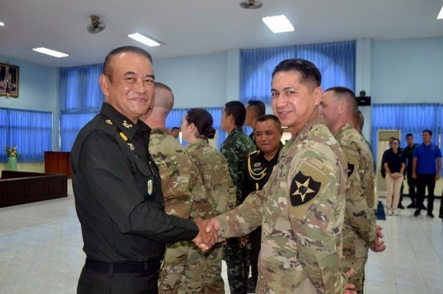 Lt. Gen. Punyaboon, commanding general, Royal Thai Army Engineer Department, greets 1st Lt. Hisac Lucas, a Soldier from the Washington Army National Guard, during the 2nd U.S.-Thai Field Engineering Subject Matter Expert Exchange, held at the Royal Thai Army Engineer School, March 18-22, 2019.