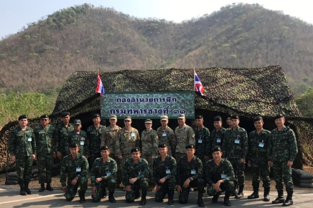 Participants from the Royal Thai Army, Washington Army National Guard, and a U.S. Army Corps of Engineers/U.S. Army Pacific representative pose for a group photo during a day of observing combat engineering training 2nd US-Thai Army Field Engineer Subject Matter Expert Exchange, held at the Royal Thai Army Engineer School, March 18-22, 2019.