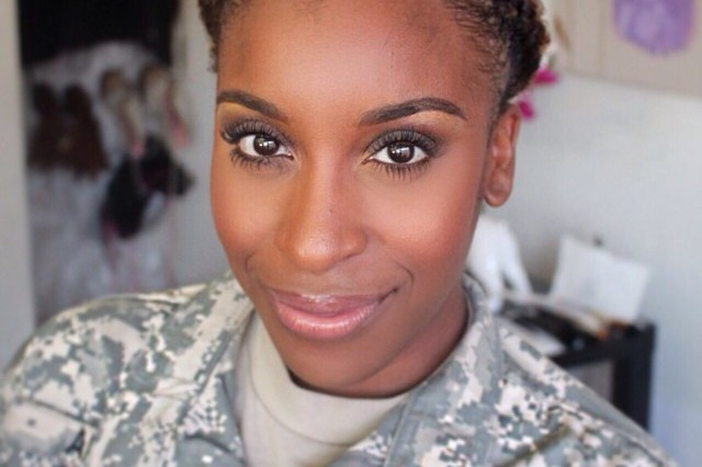 Jackie Aina poses for a selfie in her Army uniform. Since leaving the Army Reserve, Aina has amassed millions of followers as an influencer and activist on social media. She's partnered with numerous cosmetic brands to expand the diversity of shades offered.