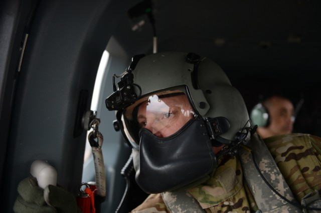 Sgt. 1st Class Jason Lawrence a crew chief with the 1-376th Aviation Battalion Lincoln, Nebraska watches for hazardous as the UH-72 Lakota helicopter flies through the sky March 23, 2019, around Lincoln, Neb. The Lakota provided aerial support to the UH-60 Blackhawks by watching for hazards in the air keeping everyone safe.