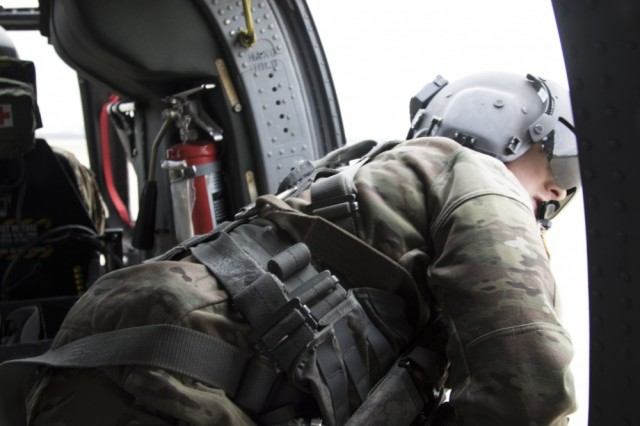 Nebraska National Guard and Minnesota National Guard Soldiers work together to perform a hay drop mission in Columbus, Neb., on March 23, 2019. The hay is for livestock that farmers can't get to because a road needs repaired.