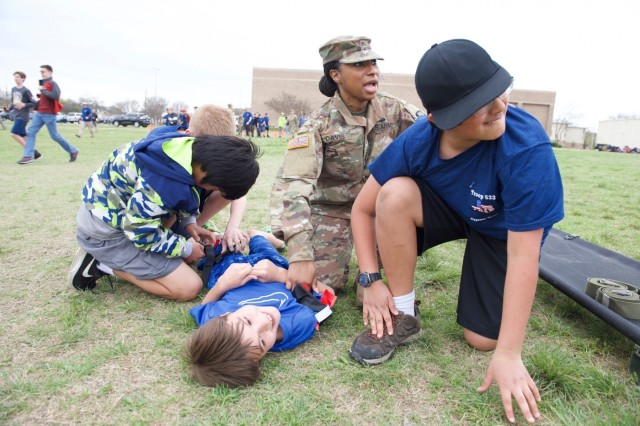 Sgt. Brittanica Davis, an operations NCO in the 1st Medical Brigade, instructs Boy Scouts through a medical training lane at Fort Hood, Texas on March 23, 2019. The 61st Quarter Master Battalion hosted 61 Boy Scouts in Troop 533 from Cypress, Texas who spent the weekend with Soldiers and learn what they do.