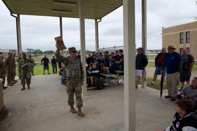 1st Lt. Alec Hernandez, Operations Officer in the 61st Quartermaster Battalion, explains a Meal Ready to Eat (MRE) to the scouts in Troop 533 from Cypress, Texas during their visit to Fort Hood on March 23, 2019. The unit hosted 61 Boy Scouts who spent the weekend at Fort with Soldiers and learned what they do.