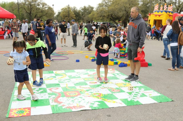 Troopers and families with the 3rd Cavalry Regiment enjoy playing games while attending a welcome home celebration March 23, 2019, at Purser Family Park in Harker Heights, Texas.