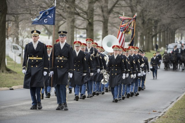 """Soldiers from the 3d U.S. Infantry Regiment (The Old Guard); The U.S. Army Band, """"Pershing's Own,"""" and The 3d U.S. Infantry Regiment (The Old Guard) Caisson Platoon, conduct military funeral honors with funeral escort for U.S. Army Air Forces Capt. Lawrence Dickson in Section 60 of Arlington National Cemetery, Arlington, Va., March 22, 2019."""